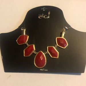 RUE21 necklace with red geometric accents